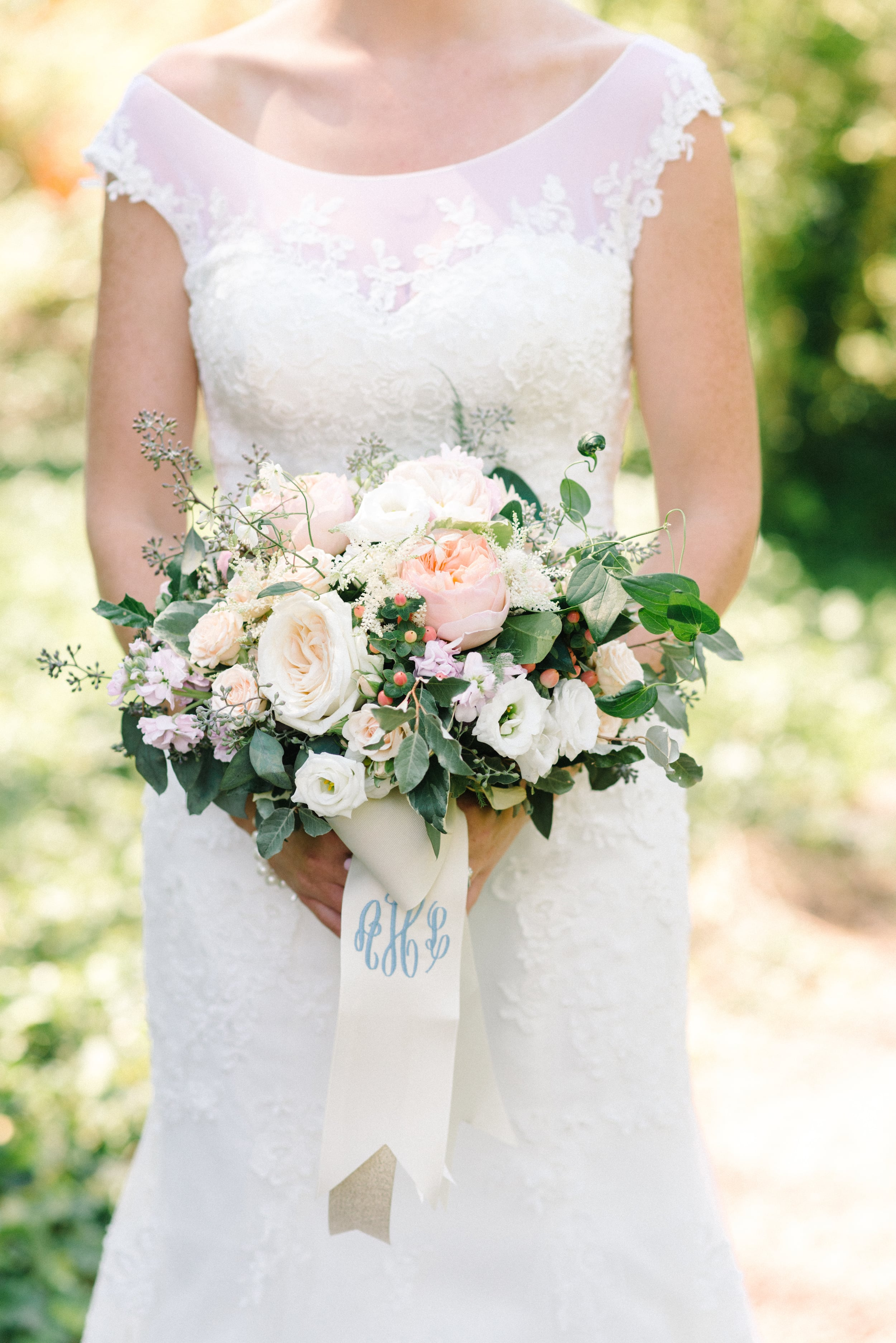 Alexandra's bouquet was gorgeous, with a combination of garden roses, lisianthus, sweet pea, eucalyptus and berries.  Her monogrammed ribbon tails were an added personal touch that we loved, and now offer to all brides!
