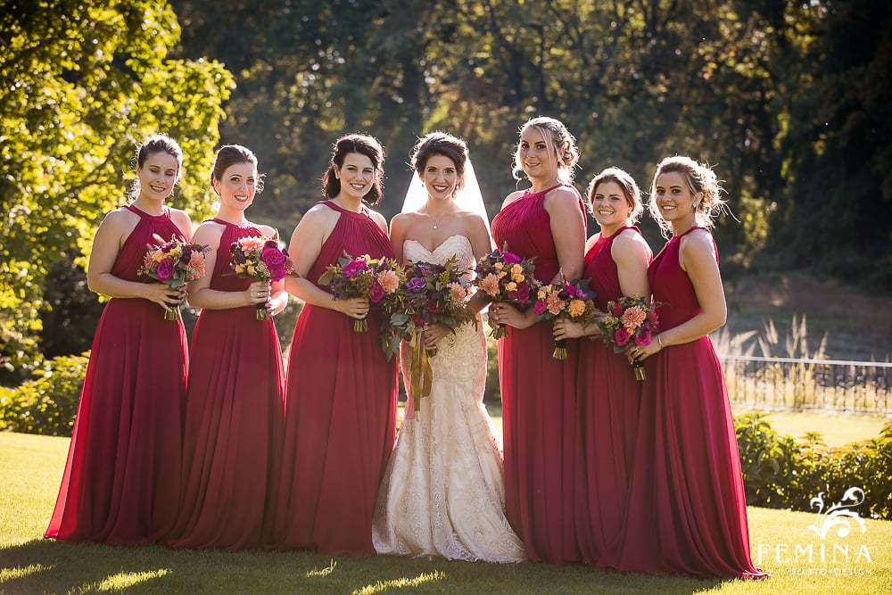 Amanda's bridesmaids wore gorgeous cranberry gowns, and carried smaller versions of the bridal bouquet.