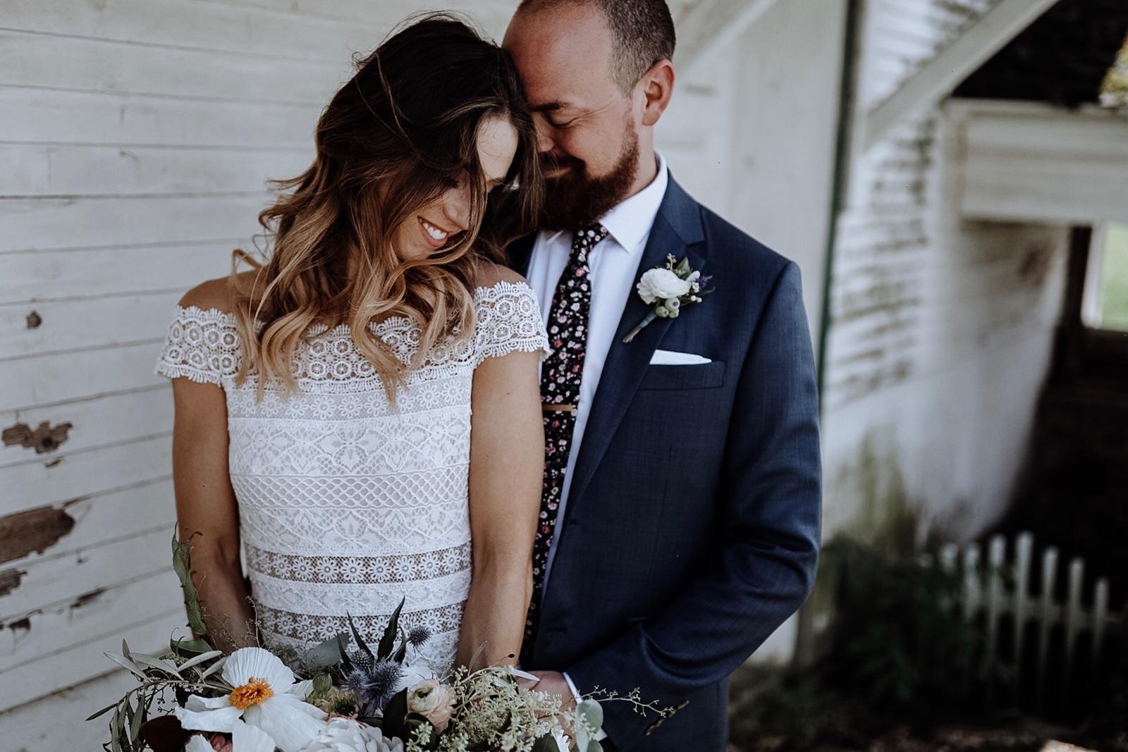 bohemian bride and groom posing