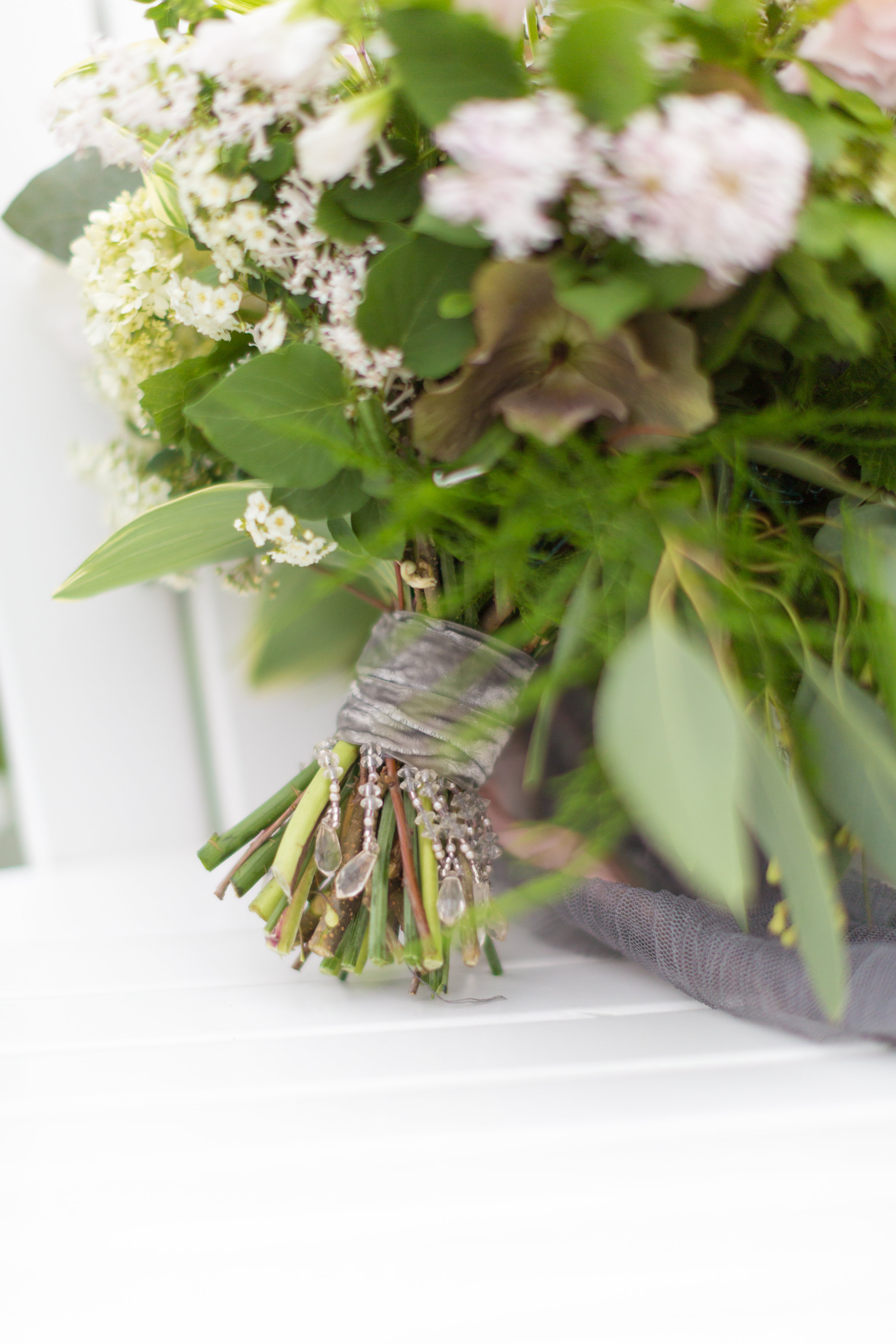 close up of crystal and ribbon bouquet wrap