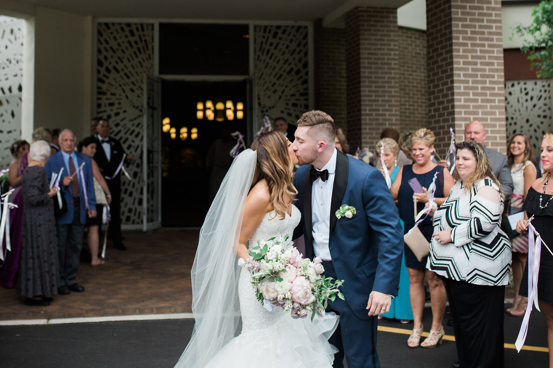 bride and groom post ceremony kiss