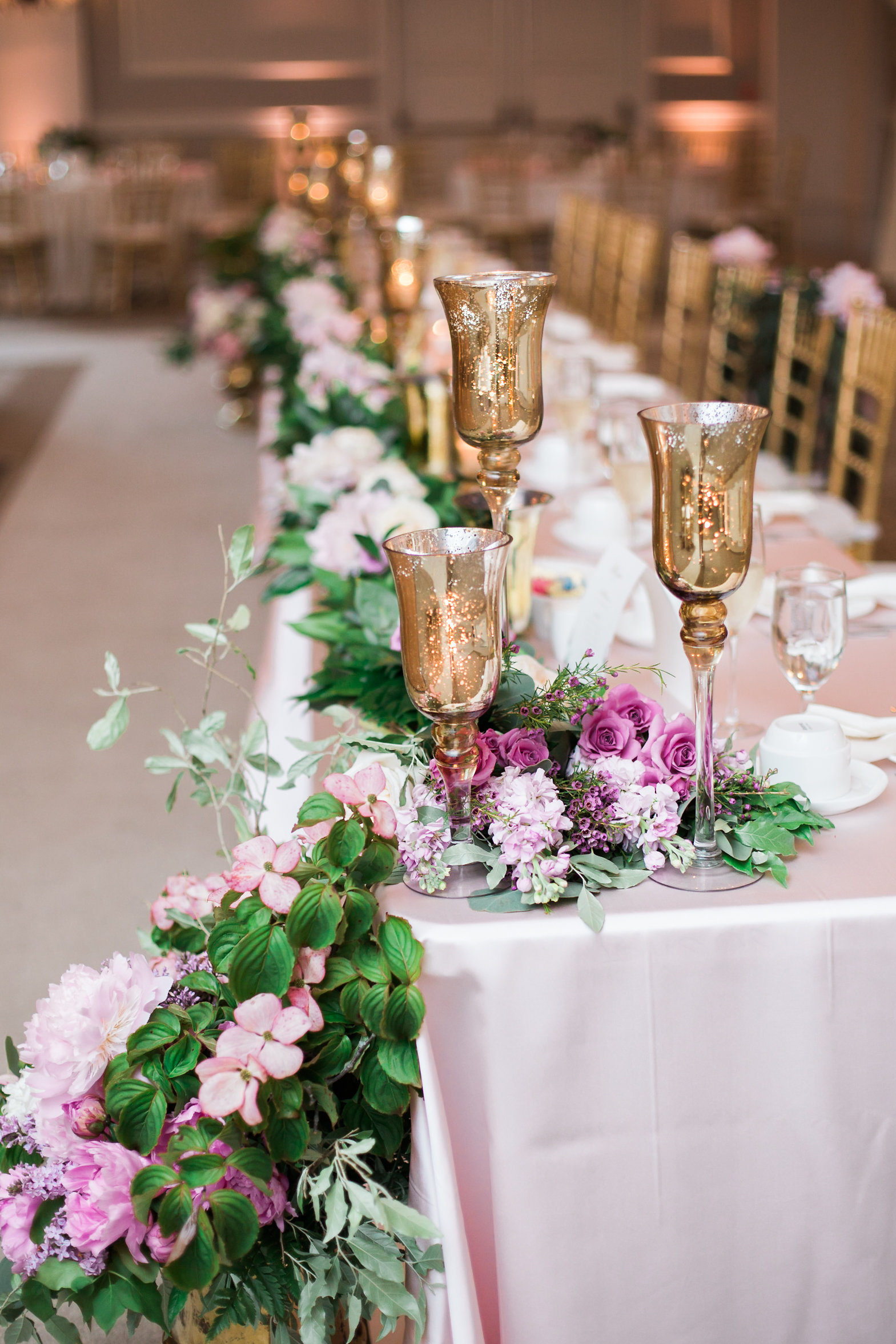 angled shot of head table with garland