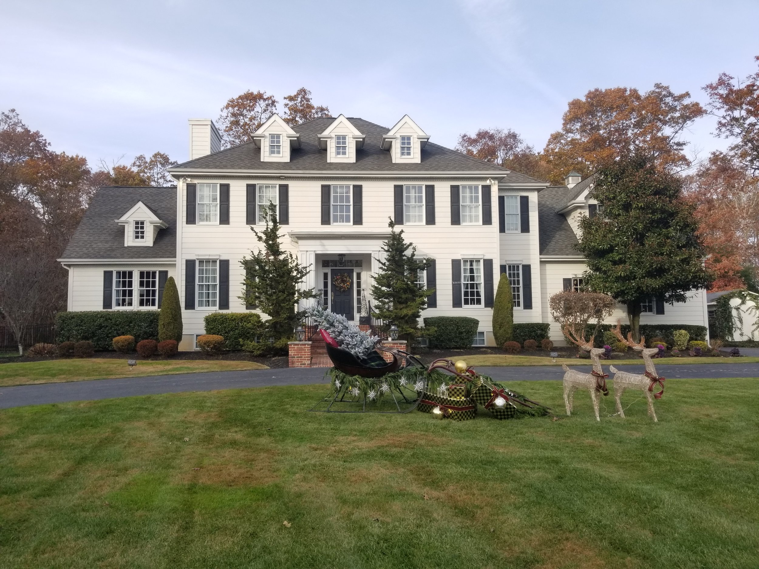 front of house with sleigh