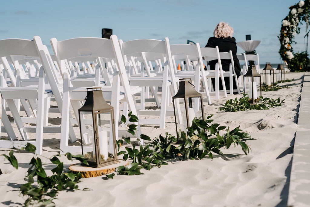 Beach ceremony with lanterns and greenery, Love Me Do Photography