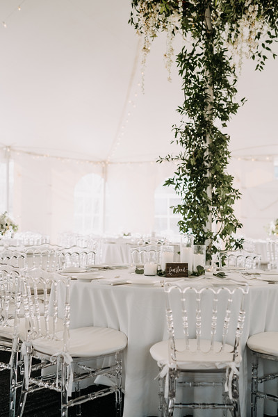 tent wedding, floral chandeliers, smilax in tent, smilax on tent poles, Love Me Do Photography, A Garden Party Florist