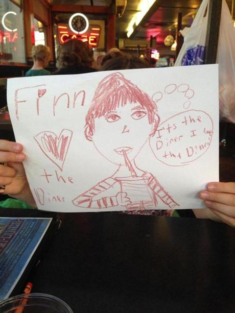 Annabel's drawing of Finn enjoying the diner.