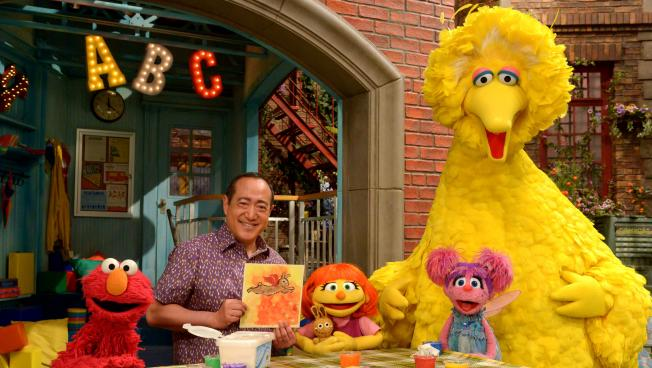 "See Amazing in all Children initiative. She'll now appear on TV as well. From left, Elmo, Alan Muraoka, Julia, Abby Cadabby and Big Bird."" Julia (center) first appeared online and in printed materials as a part of Sesame Street's See Amazing in all Children initiative. She'll now appear on TV as well. From left, Elmo, Alan Muraoka, Julia, Abby Cadabby and Big Bird. Credit: Zach Hyman"