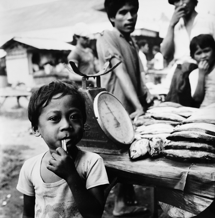 Ans Westra  Streetmarket around bus depot, Cagayan de Oro on Mindanao, Philippines , 1986 Silver gelatin print 285 x 280 mm   _______