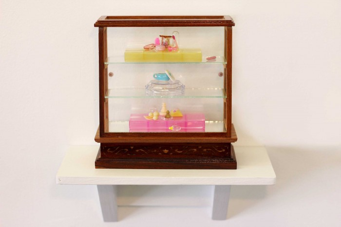 Emily Hartley-Skudder  Yellow and Pink Tiered Collection , 2013 Found objects on ply shelf 160 x 155 x 65 mm   _______