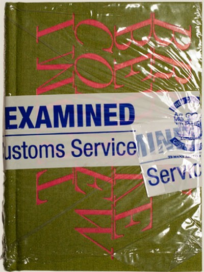 EXAMINED [front], Italy/New Zealand , 2009 'I Must Behave Book', plastic wrap, NZ Customs Service tape 167 x 121 mm object size, upright   _______