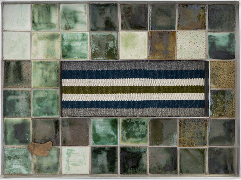 Tia Ansell  Bundle I , 2018 Hand spun, dyed (with indigo, moss and charcoal) and backstrap woven woolen tapestry; stoneware tiles; bronze brooch; aluminium; grout and ply 450 x 340 mm  _______