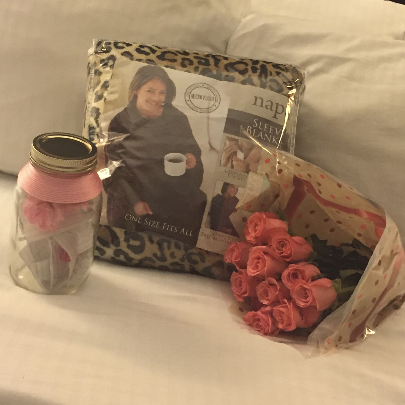 My roses, some love notes, and a Snuggie. If you know me at all you know I am always cold lol