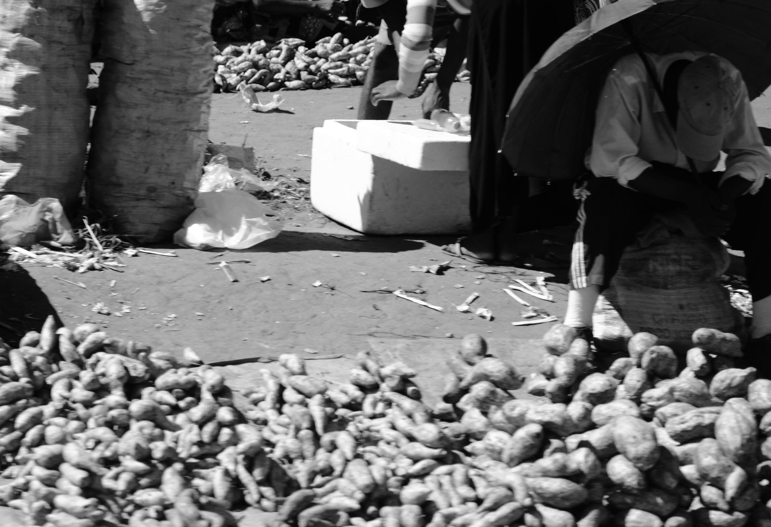 Man, Umbrella and Potatoes.JPG