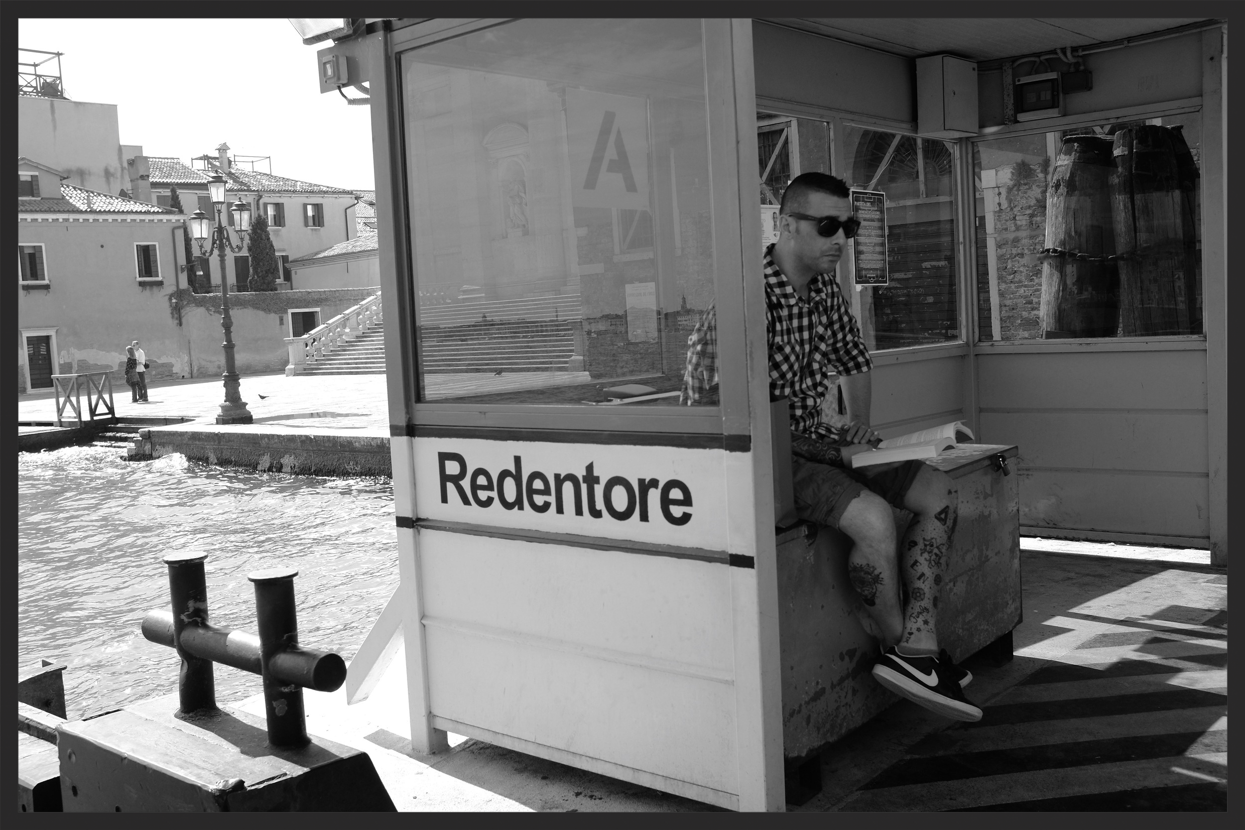 Waiting at the Redentore vaporetto stop.