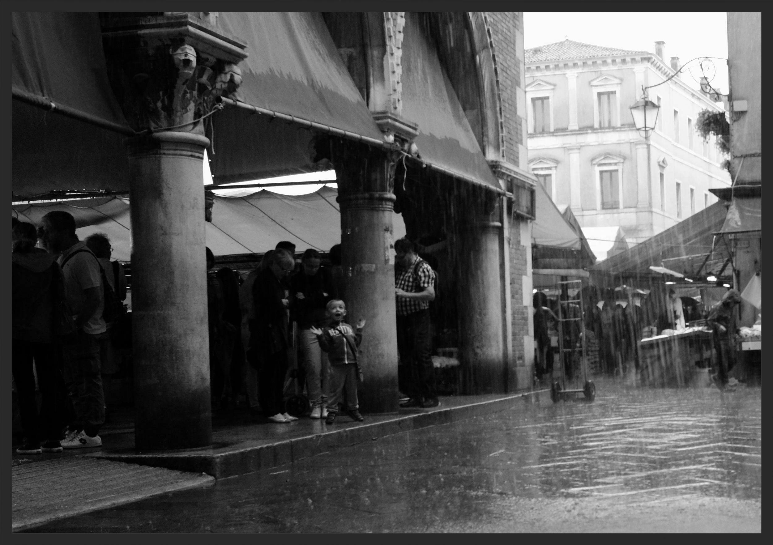Delight at the rain outside the Rialto Market.