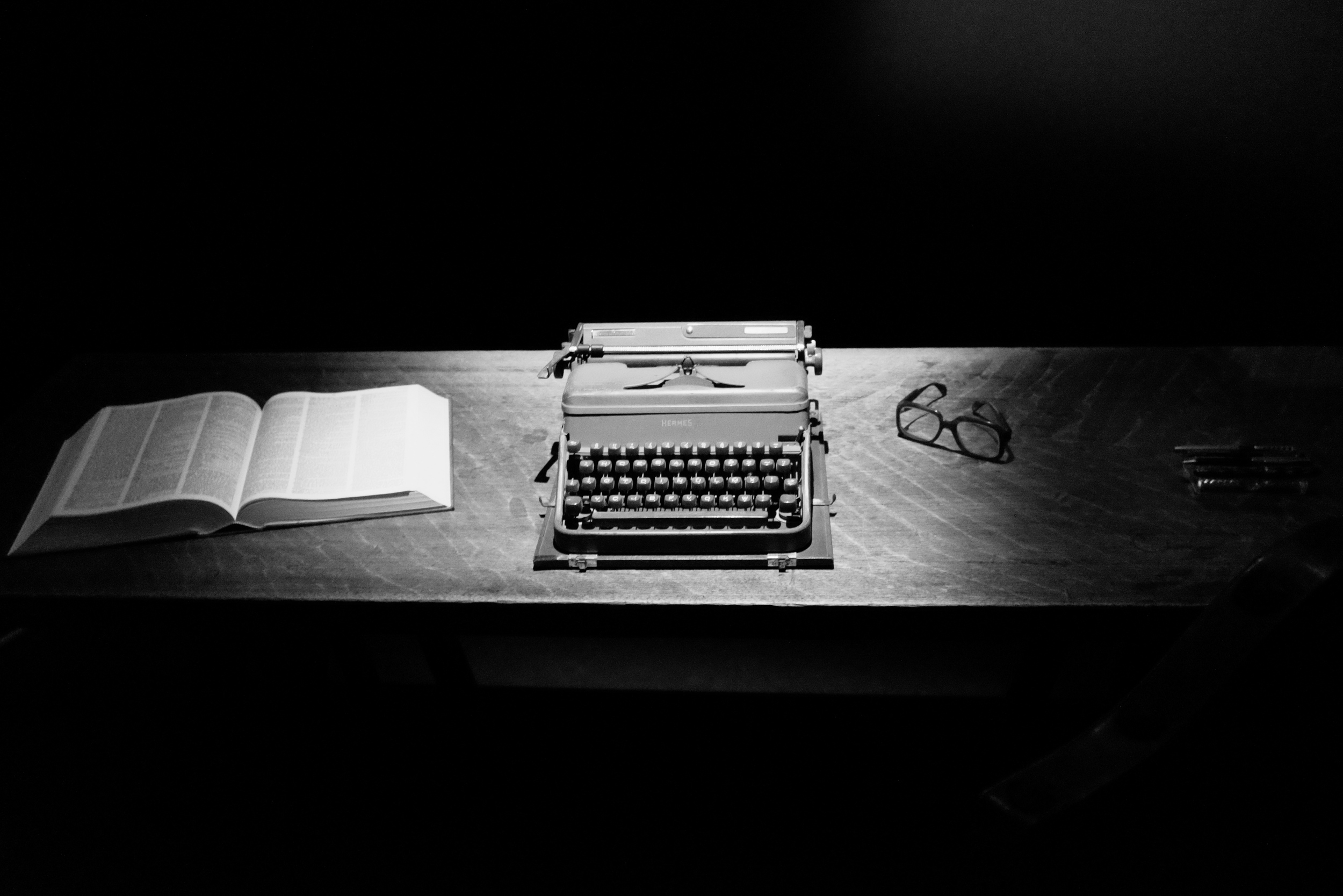 The author's desk, typewriter, dictionary and unmistakable eyeglasses.