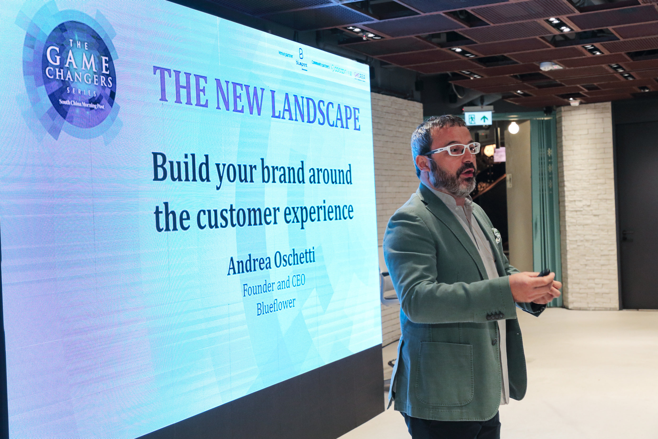 """Andrea Oschetti, Founder and CEO, Blueflower, speaking on """"Build your brand around the customer experience""""."""