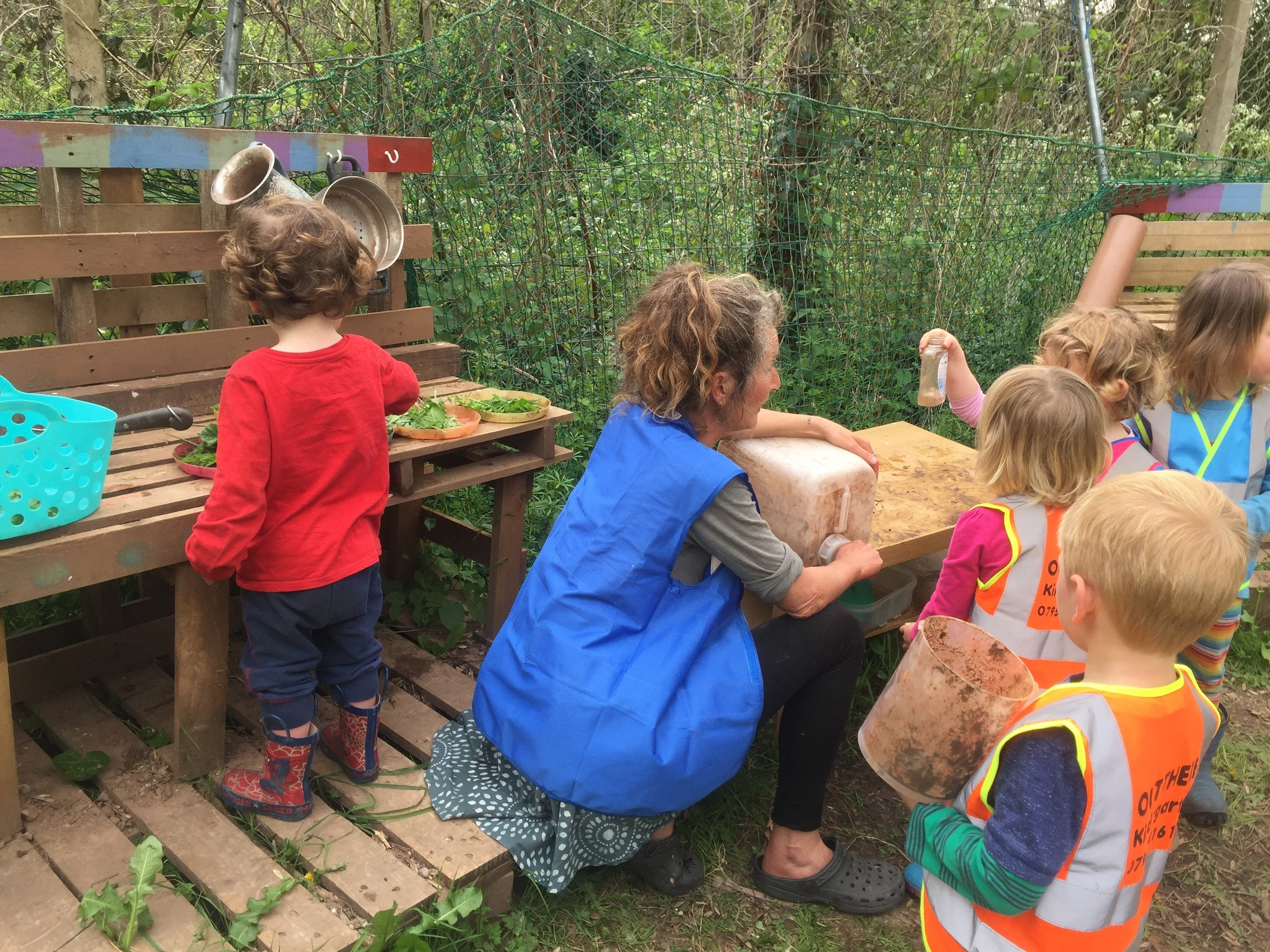 In the mud kitchen
