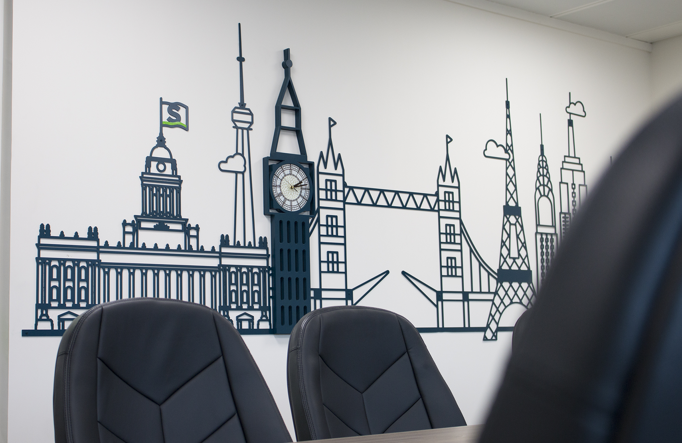 Bespoke metal skyline, inline with the Sentio brand - with working clock face