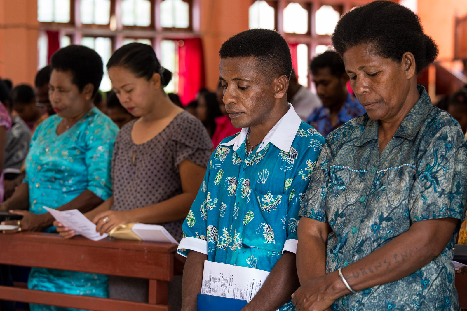 Yosua attends Sunday worship with his family. He is grateful and thanks God for his health.