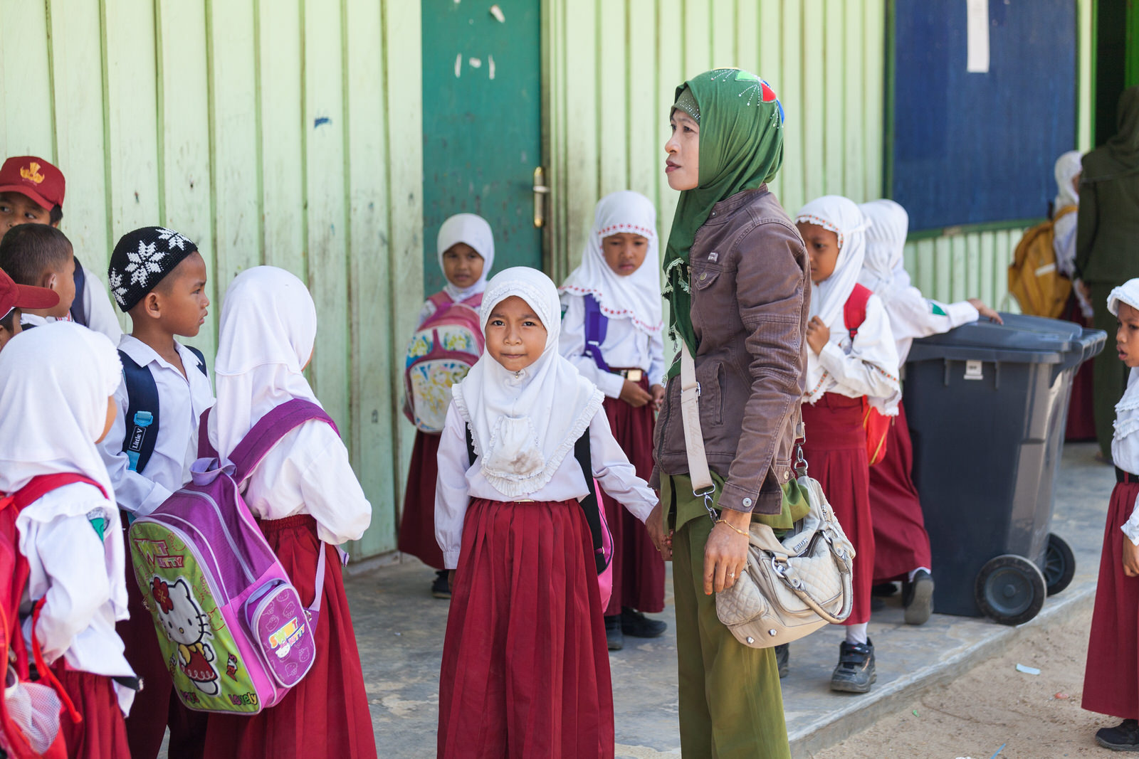 Ibu Ratna and Amel wait outside the classroom for school to begin.