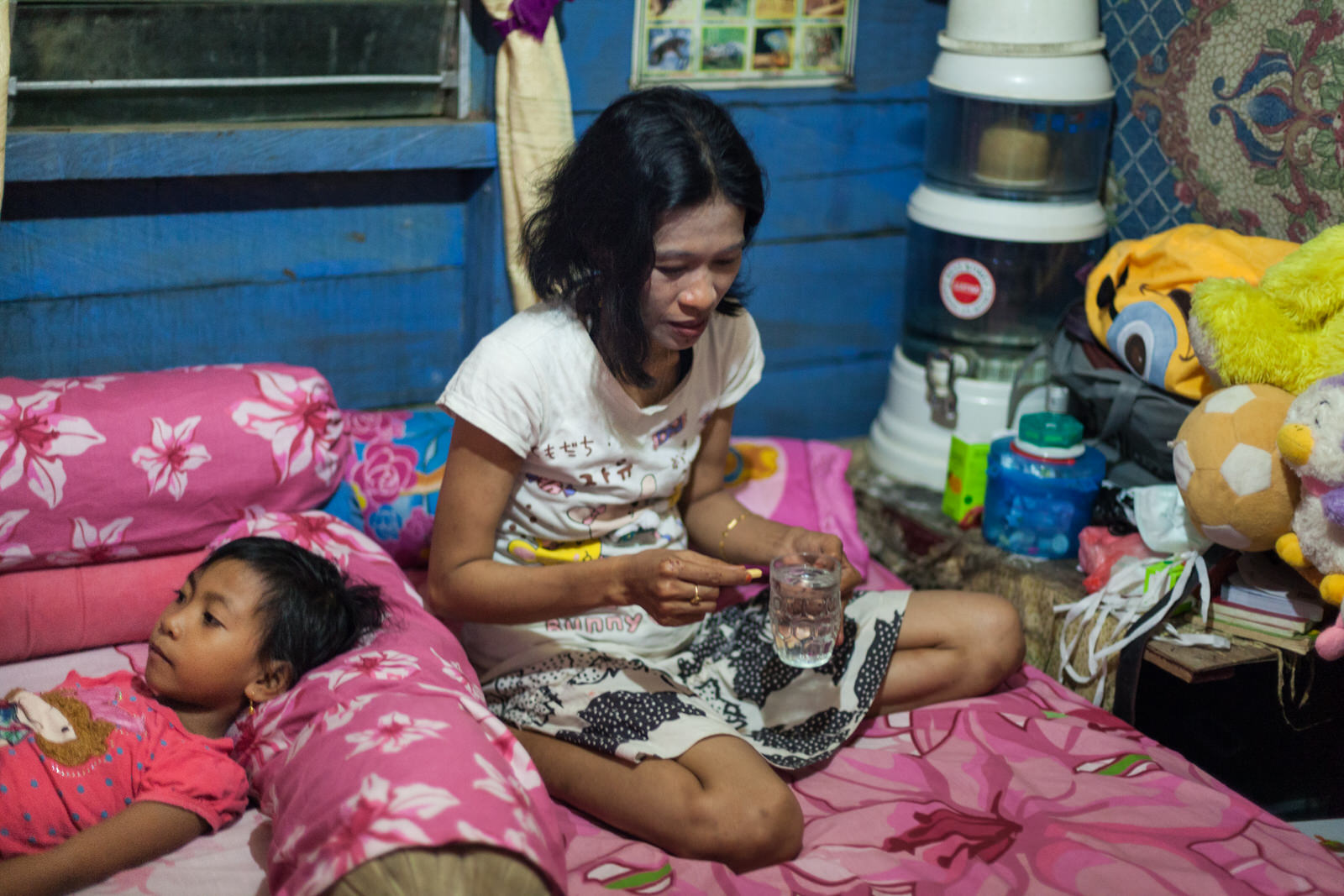 Ibu Ratna takes ARV (Antiretroviral medicine) before going to sleep.  She has been on ARV for 5 years.
