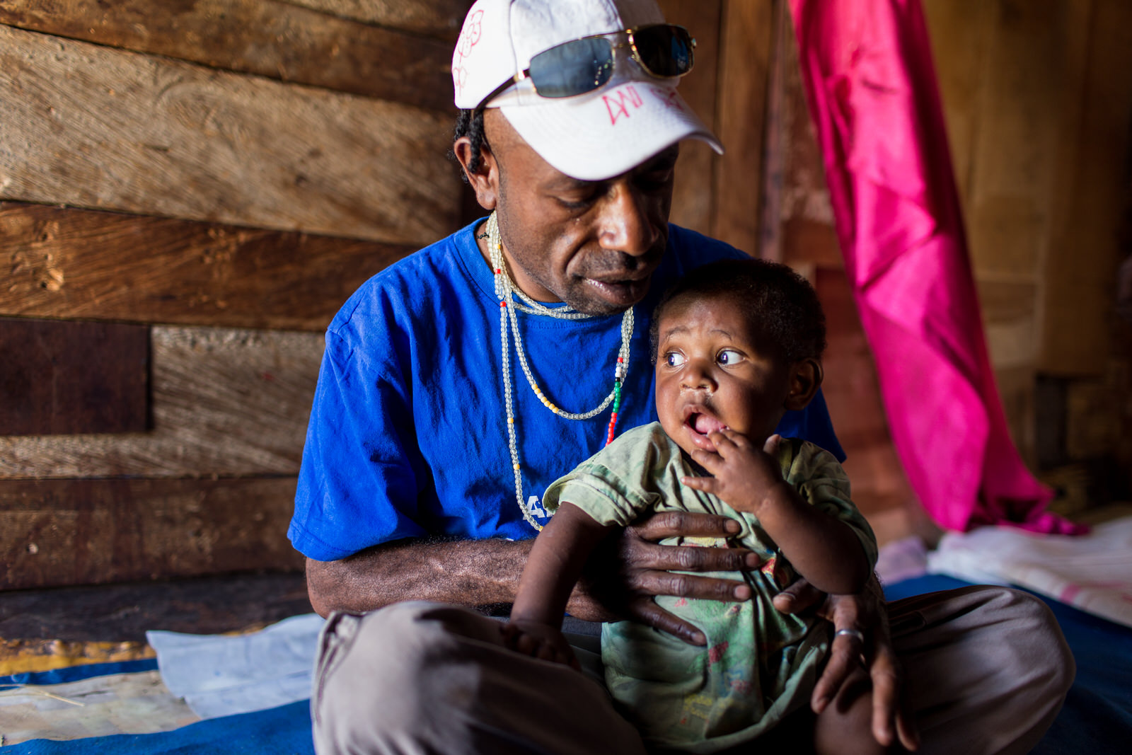 Wesley spends time with a baby boy whose mother has died from AIDS.