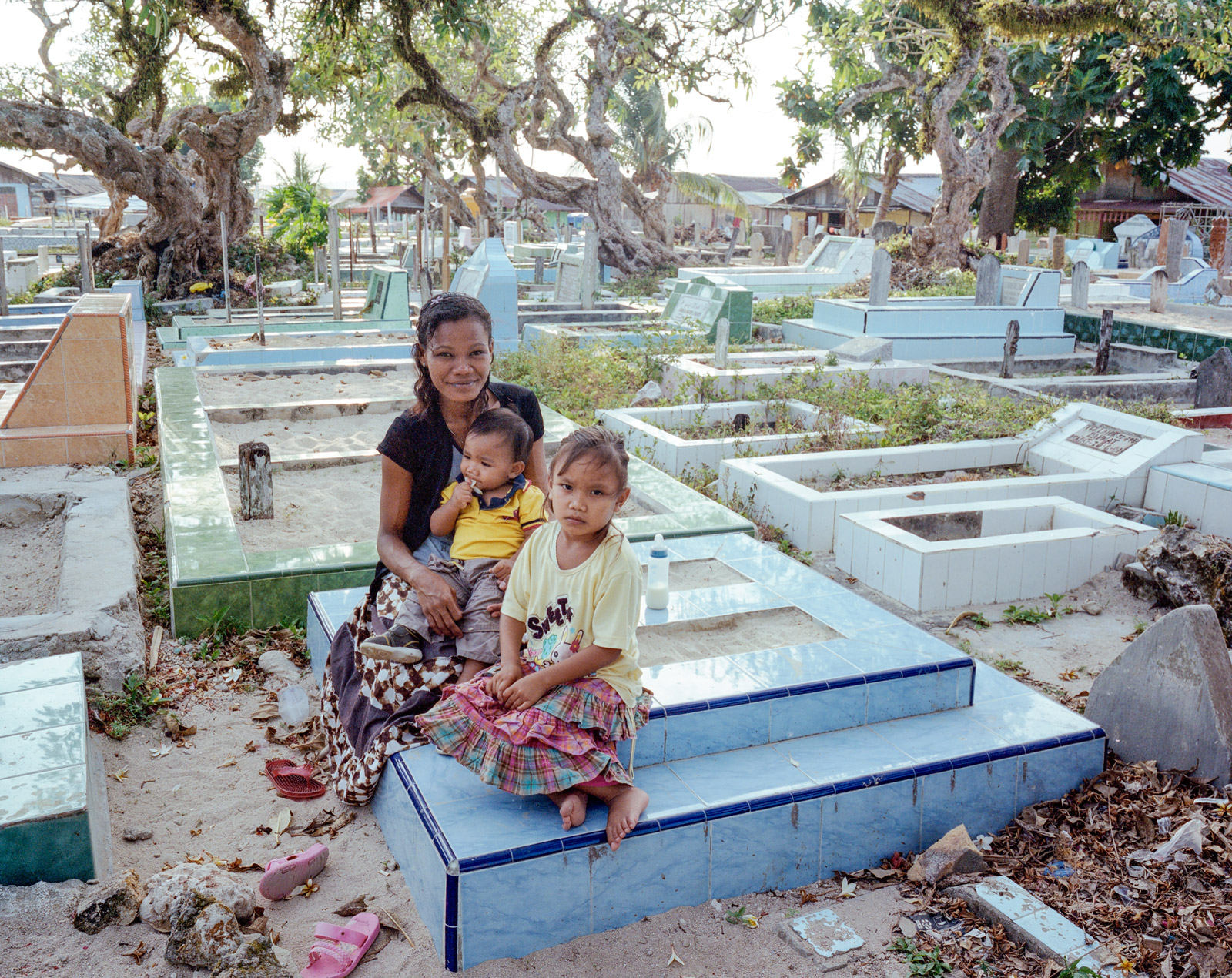 Ibu Siti takes Young and Vio to visit Haikal's grave.