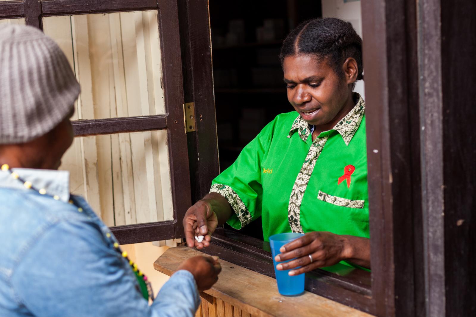 A nurse at Klinik Kalvari in Wamena gives medicines to a patient.