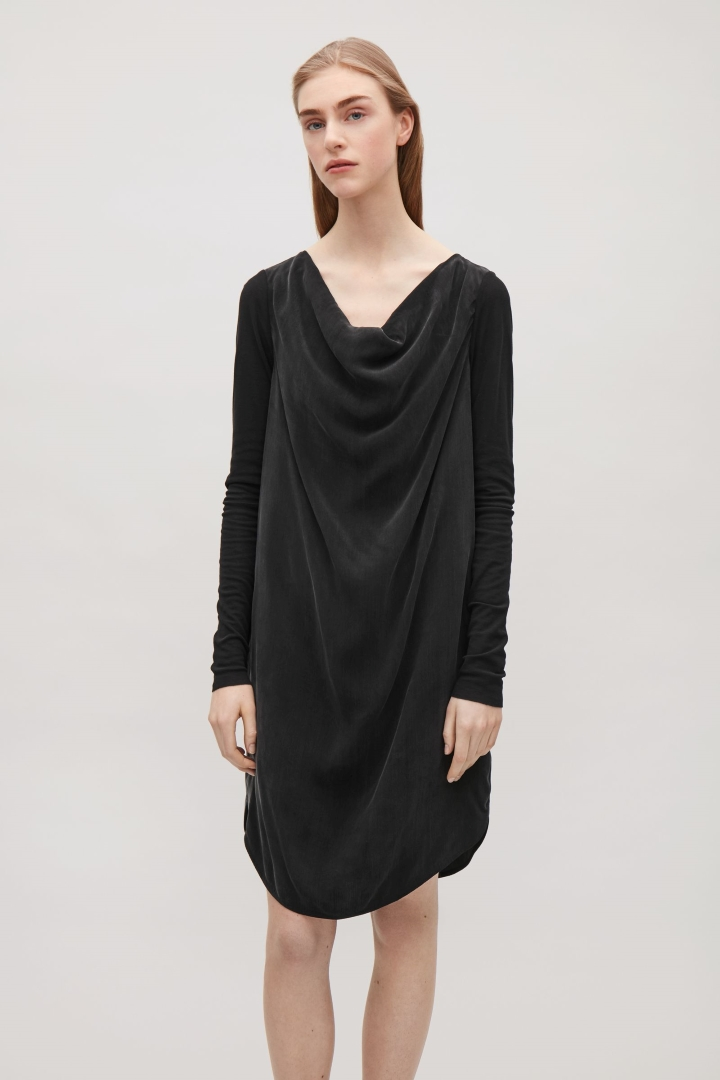 COS DRESS - _____________This draped black dress is very versatile and would look as amazing over jeans as it would with bare legs and your best Ann D boots...if you're me.