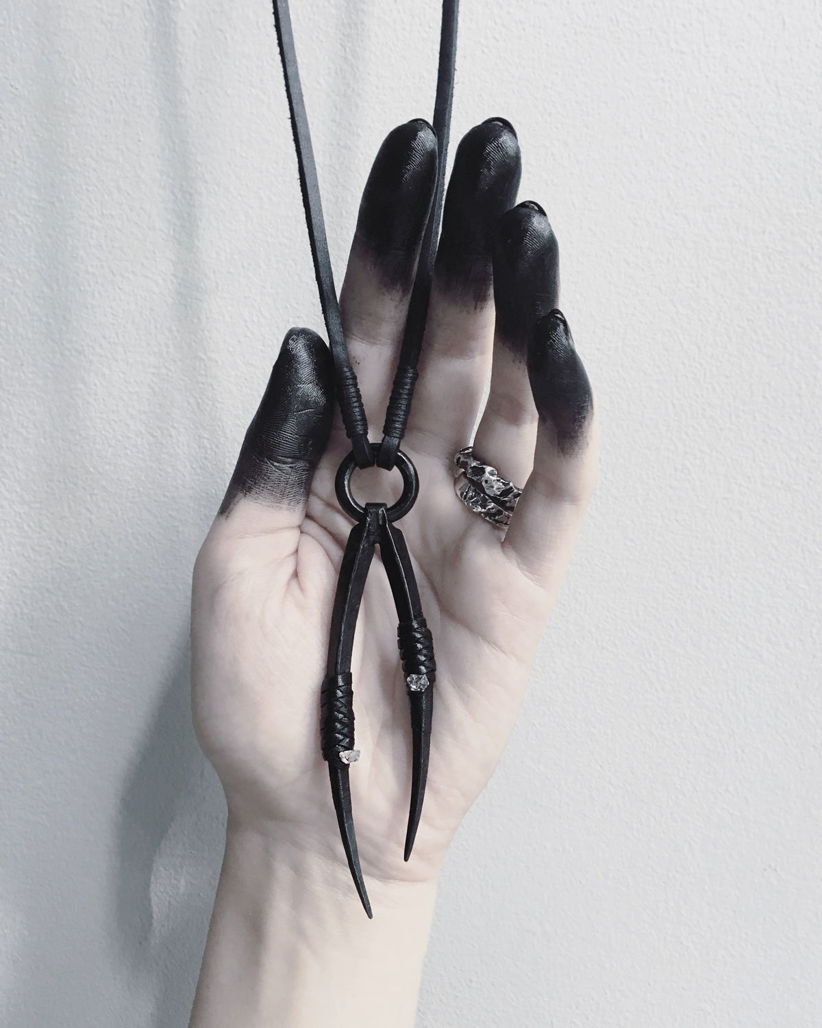 PEDIPALP NECKLACE - This. I need this. Black wrought iron with little Quartz inserts, wrapped in black leather. Oh my goodness.