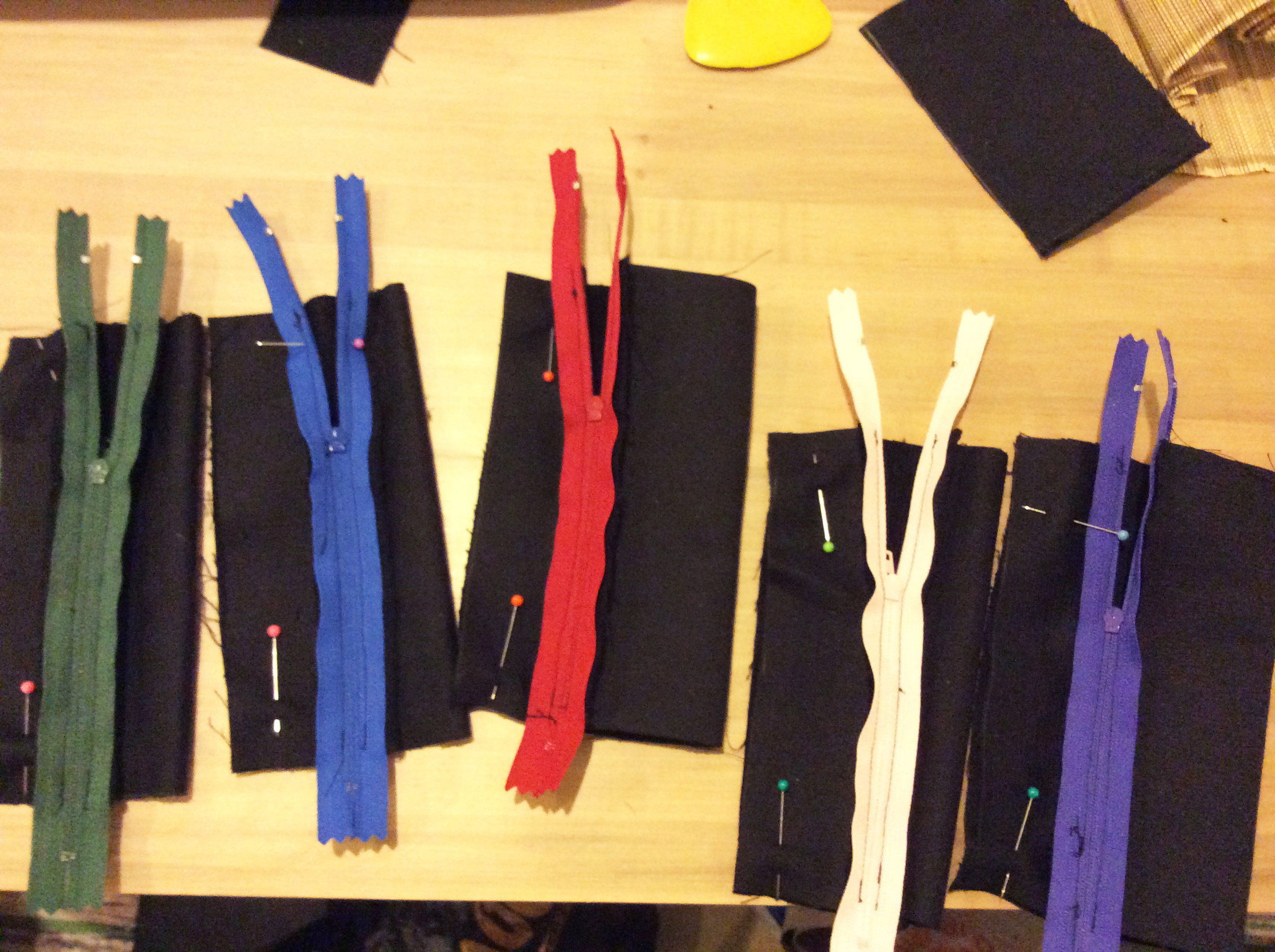 Fold the project in half, right side in, with the zippers open far enough to turn them right side out after stitching.