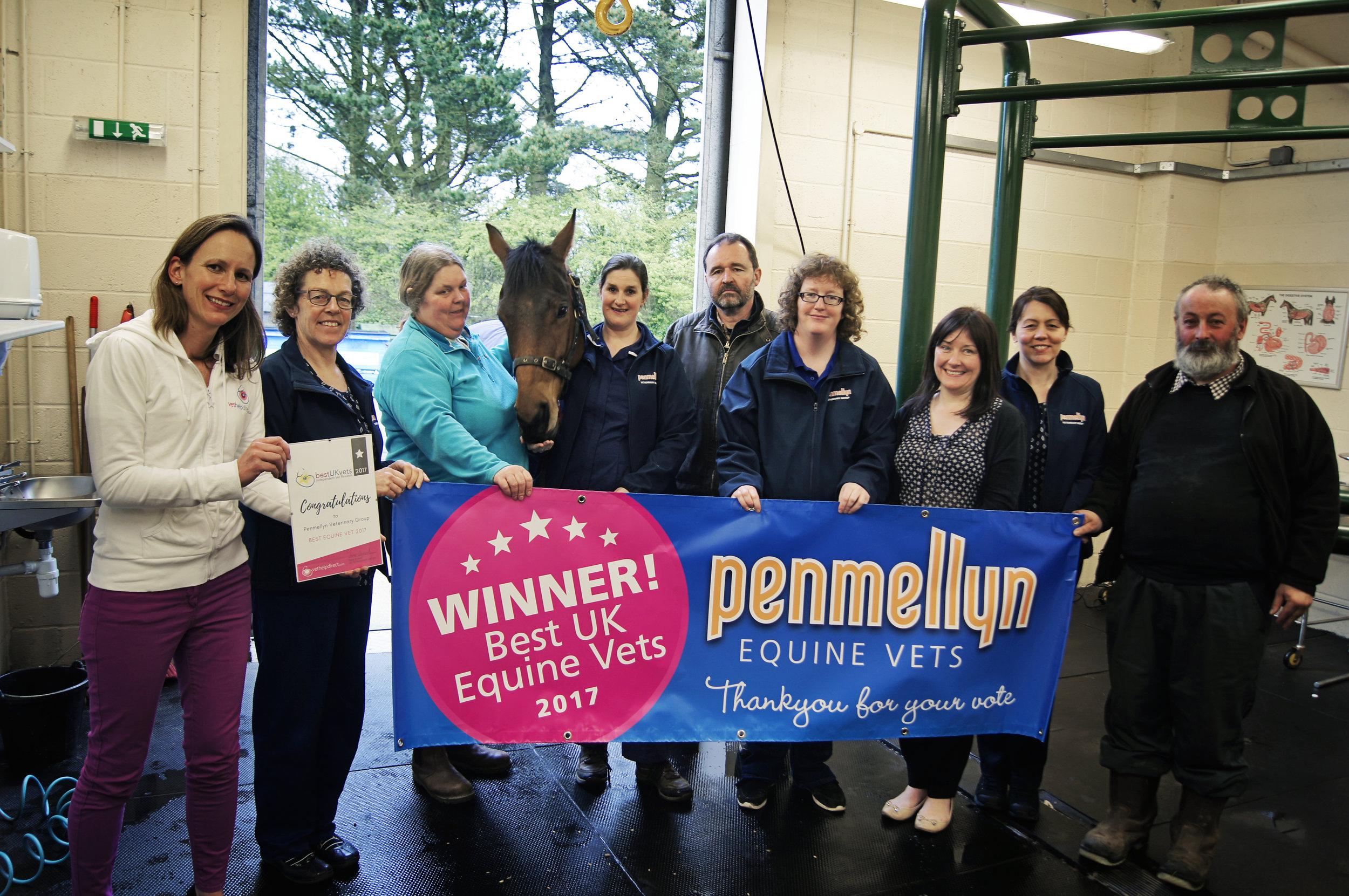 Penmellyn Vets' equine team receiving certificate for Best Equine Vets from Susie Samuel.