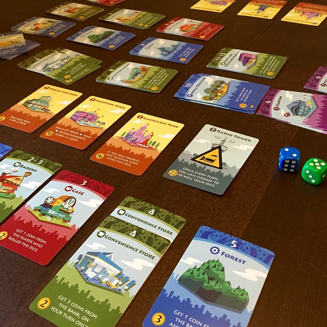 Machi Koro...player 1 nearing victory. From: https://instagram.com/p/zJD6uBDDhY/