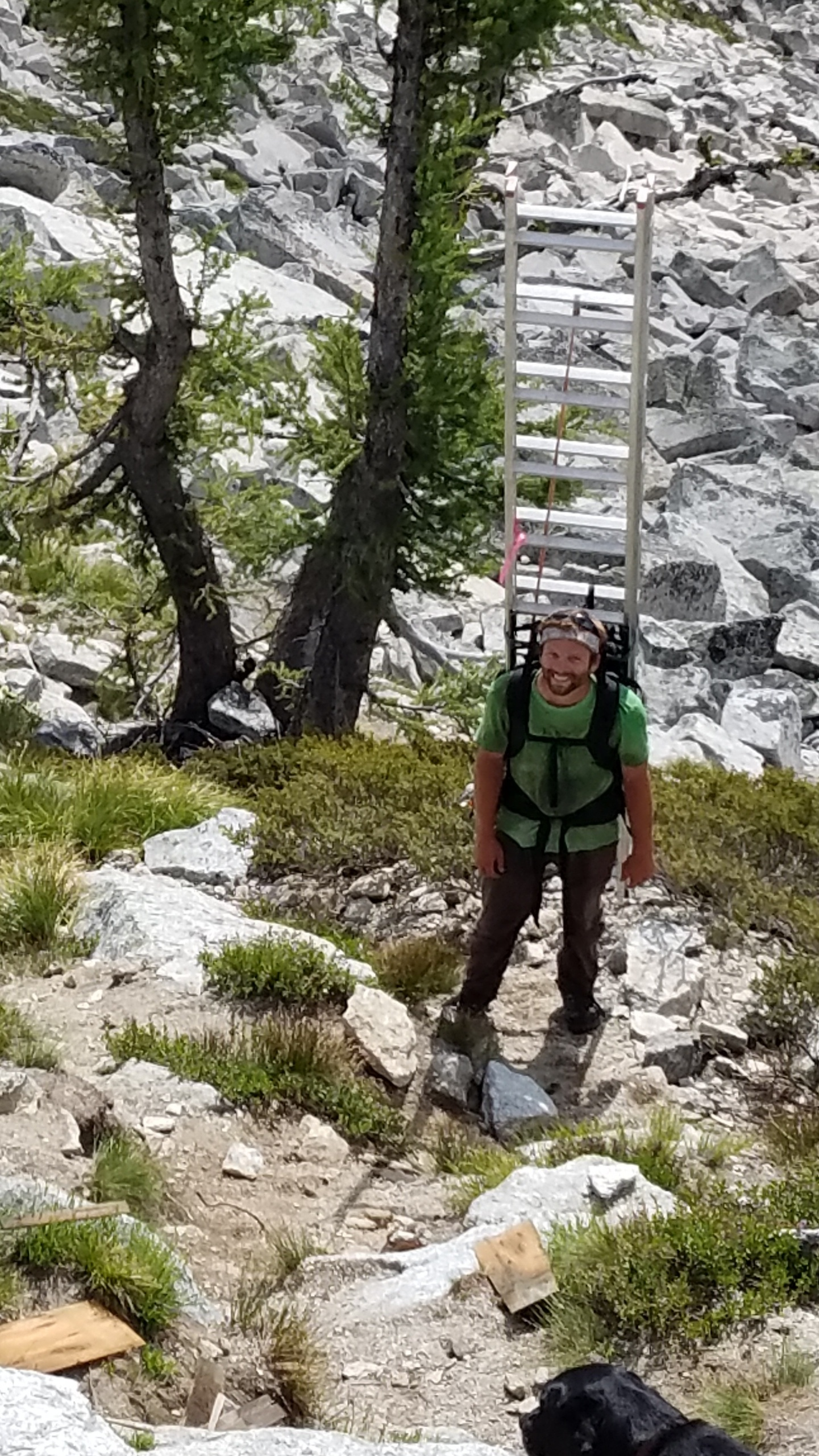 Conner carrying the ladder.  Five plus miles - 3,000 ft elevation gain.