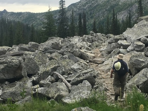 An SBFC volunteer hikes up the trail