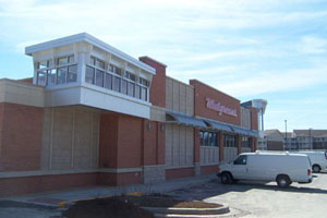 Walgreen's State Street:  We fabricated the structural and miscellaneous steel as well as furnished the steel joist and roof deck for over 36 Walgreens. Each Walgreens building configuration varies slightly depending on the jurisdiction of the community and its architectural requirements. This particular Walgreens has many architectural elements that required steel fabrication. Decorative awning support brackets, an unusual drive thru canopy and an atypical entry tower adorn this building. Steel lintels, ladders, dumpster gates downspout protectors and a satellite support column are the typical elements that we also supplied.