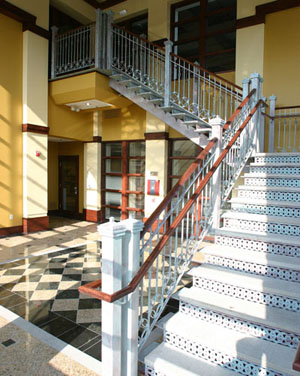 Oconomowoc Lake Plaza:  For this project, we were awarded the Bronze Award for Stairs Complete at the 2005 National Ornamental and Miscellaneous Metals Association (NOMMA) Top Job competition. An interesting combination of Mediterranean style railings, decorative laser cut risers, stone treads, and steel tube stringers embellish the entry to the retail plaza.