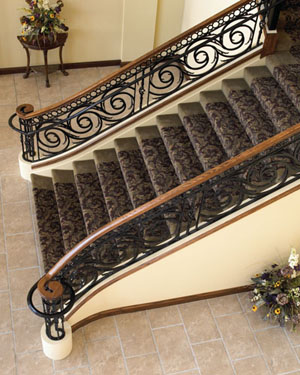 The Legend of Brandy Brook:  For this project we were awarded the Gold Award for Interior Railings at the 2004 National Ornamental and Miscellaneous Metals Association (NOMMA) Top Job competition. This monumental stair in the clubhouse main entrance of a private country club makes a grand statement to visitors. Laser cut panels from 3/4 inch steel plate, stock basket pickets, and cast iron components emulate a railing forged over anvil from years past.