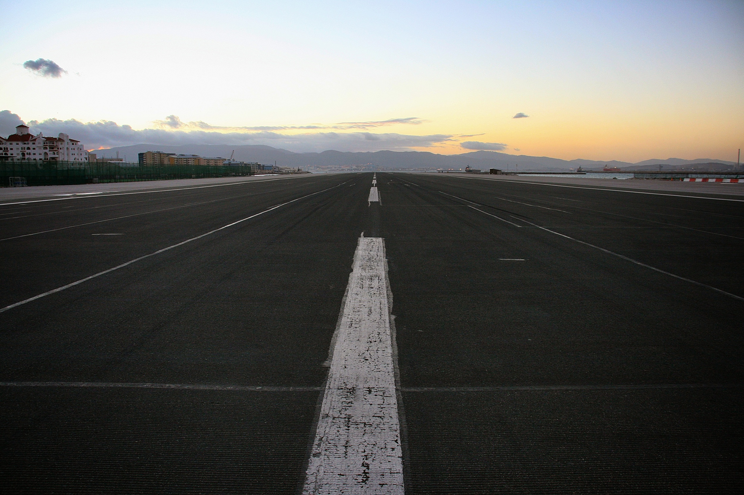 Gibraltar airport.  The only way of entering Gibraltar by land or by air is by crossing the main active runway.