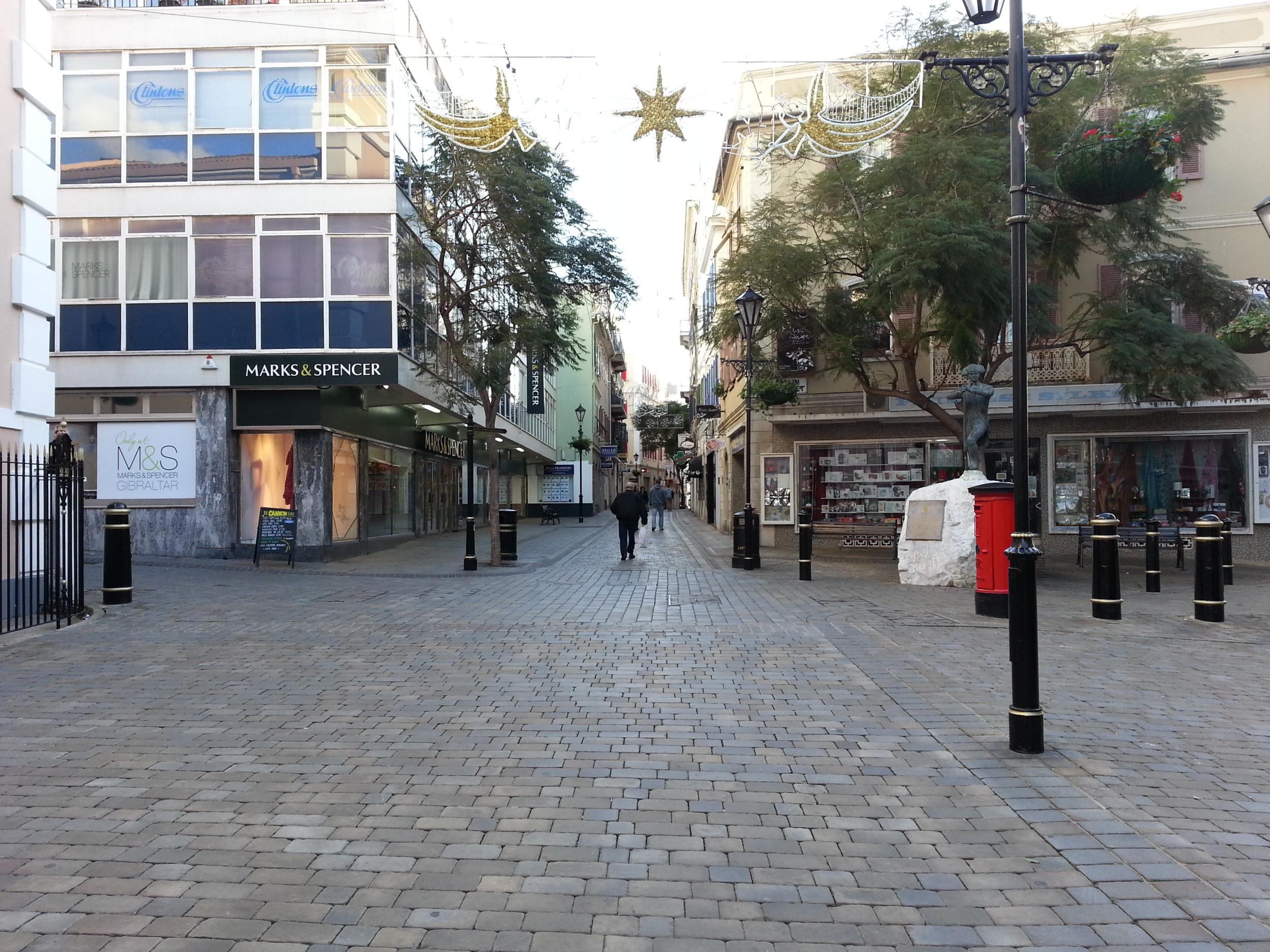 Gibraltar . Main Street has some international store brands. Nevertheless Gibraltarians also shop in neighboring Spain.