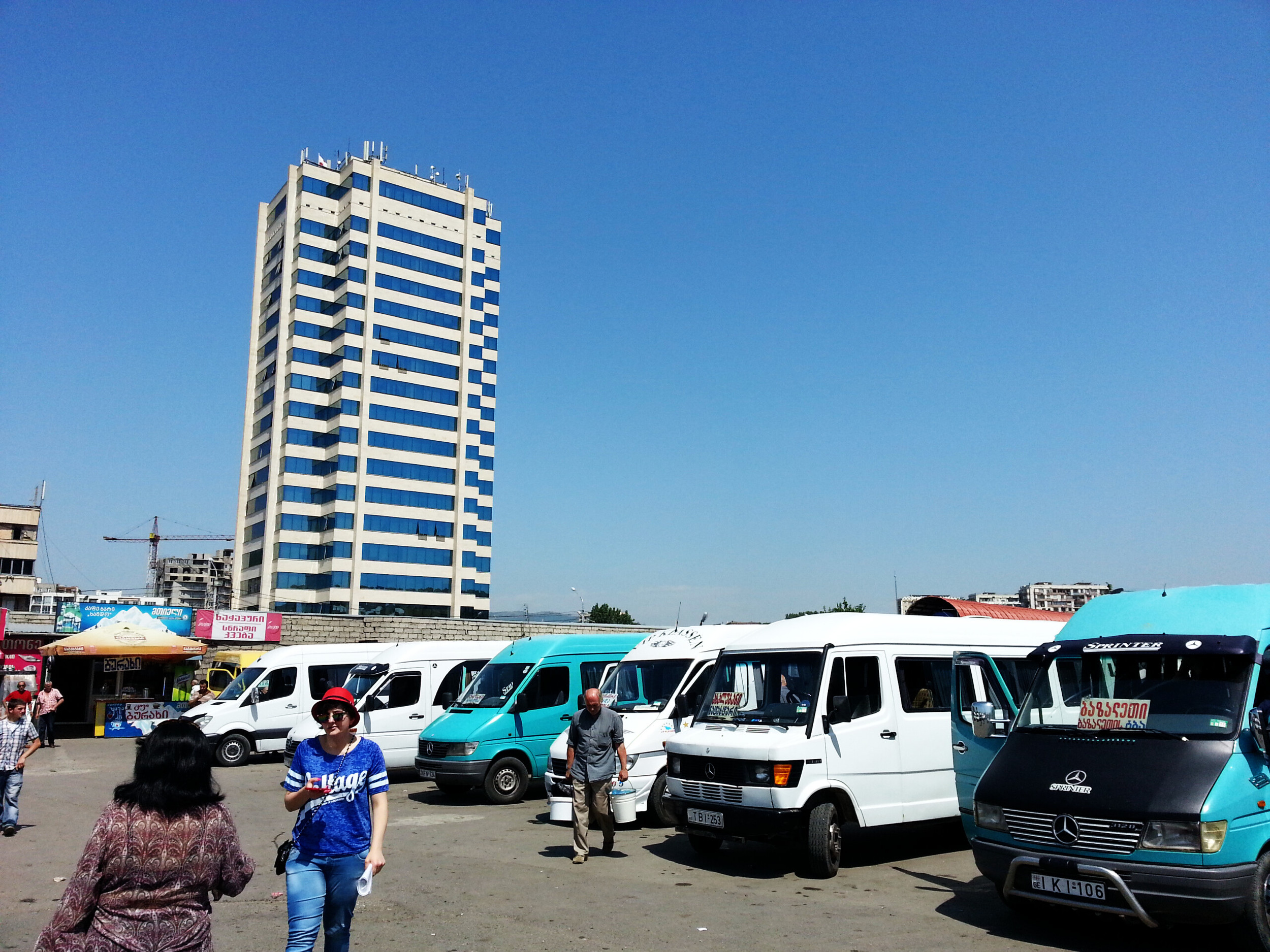 Tbilisi,Didube bus station.  Most minibus destination signs are in Georgian...