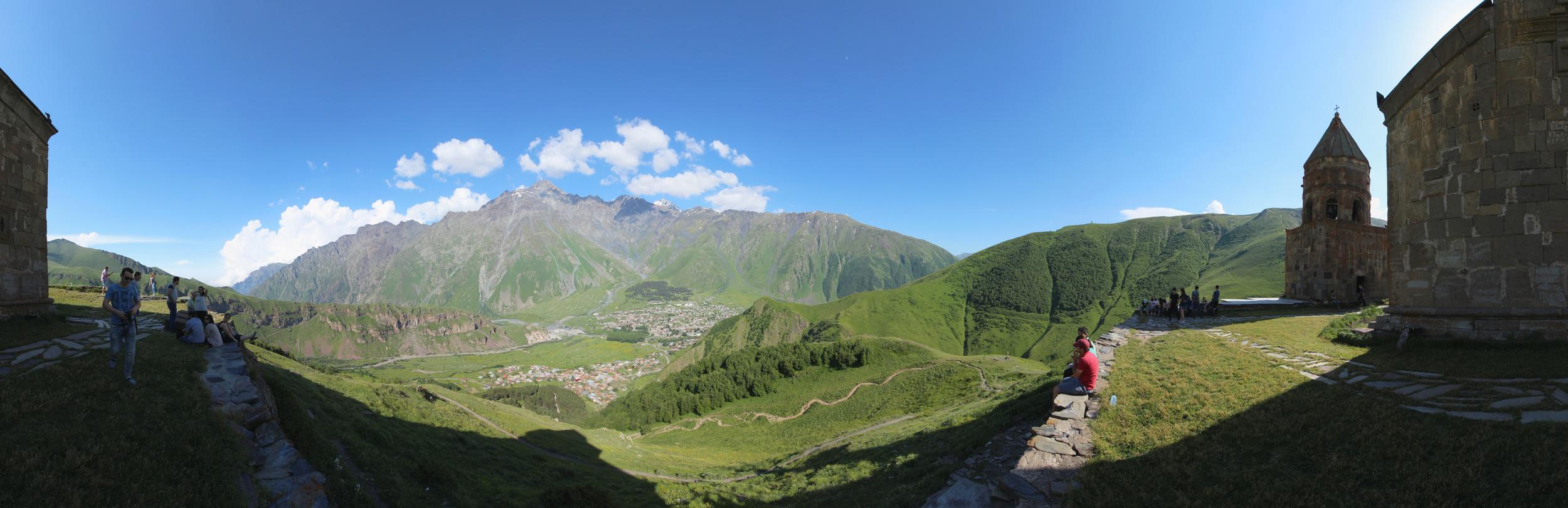Kazbegi . Panoramic view to Stepantsminda from the Gergeti Trinity Church