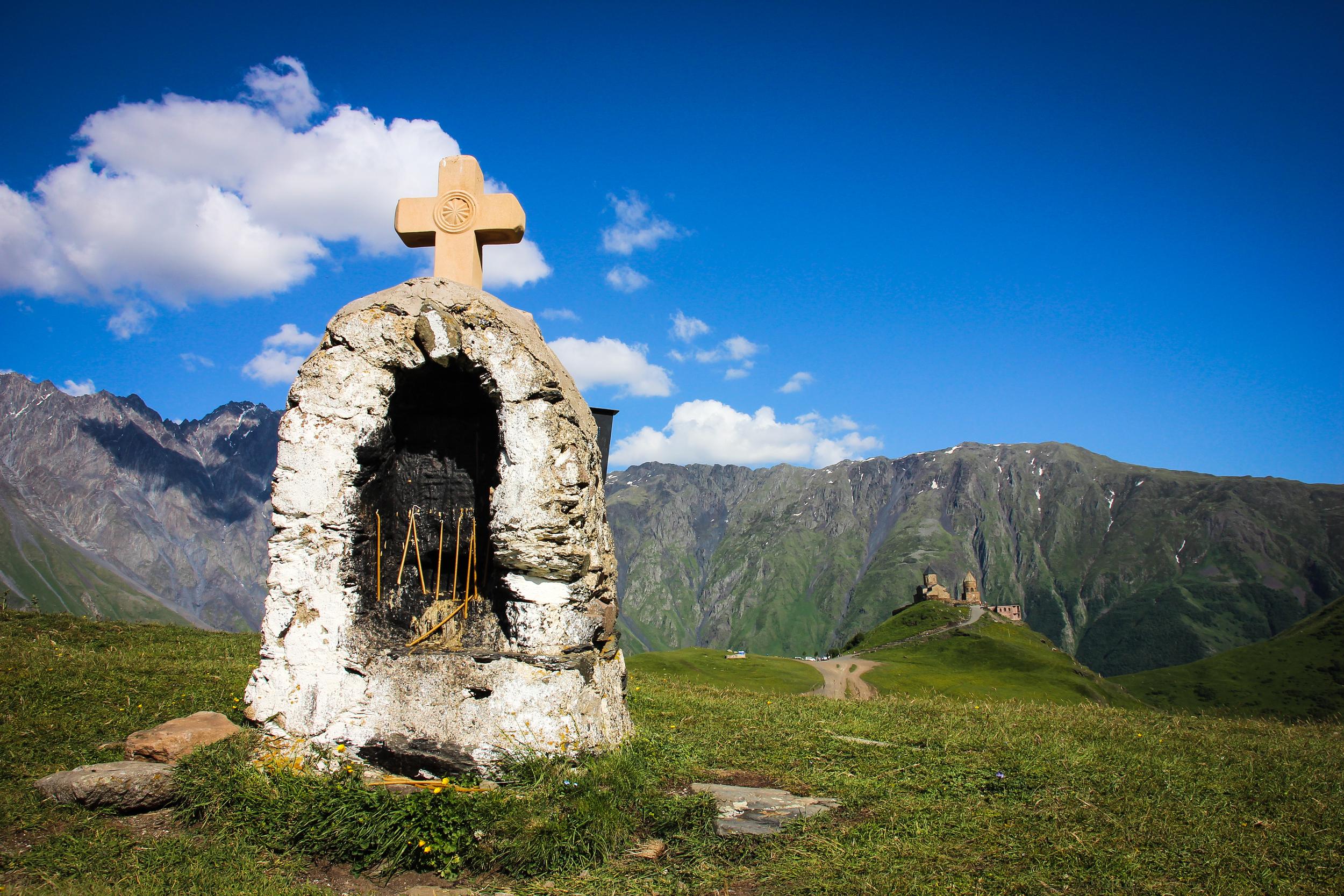 Kazbegi . Gergeti Trinity Church in the far. Trekking to the church takes around 3-4 hours.