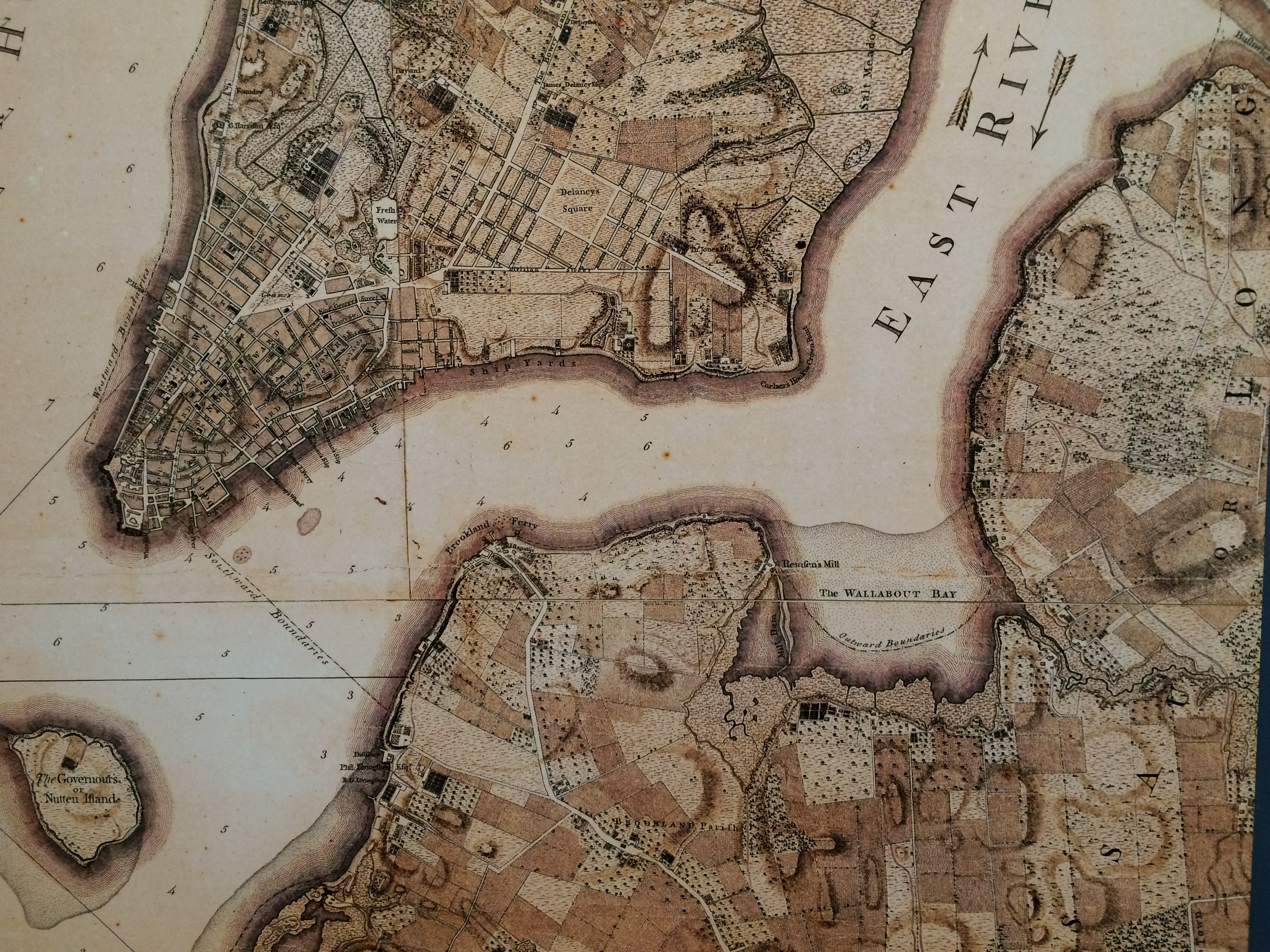 """Plan of the City of New York showing """"Brookland"""" as a mosaic of farms with shades bisected by Flatbush road. Wallabout Bay is shown just below the """"E"""" in East River and is the location of the BNY. Rendition by Army Lieutenant Bernard Ratzer, 1770."""