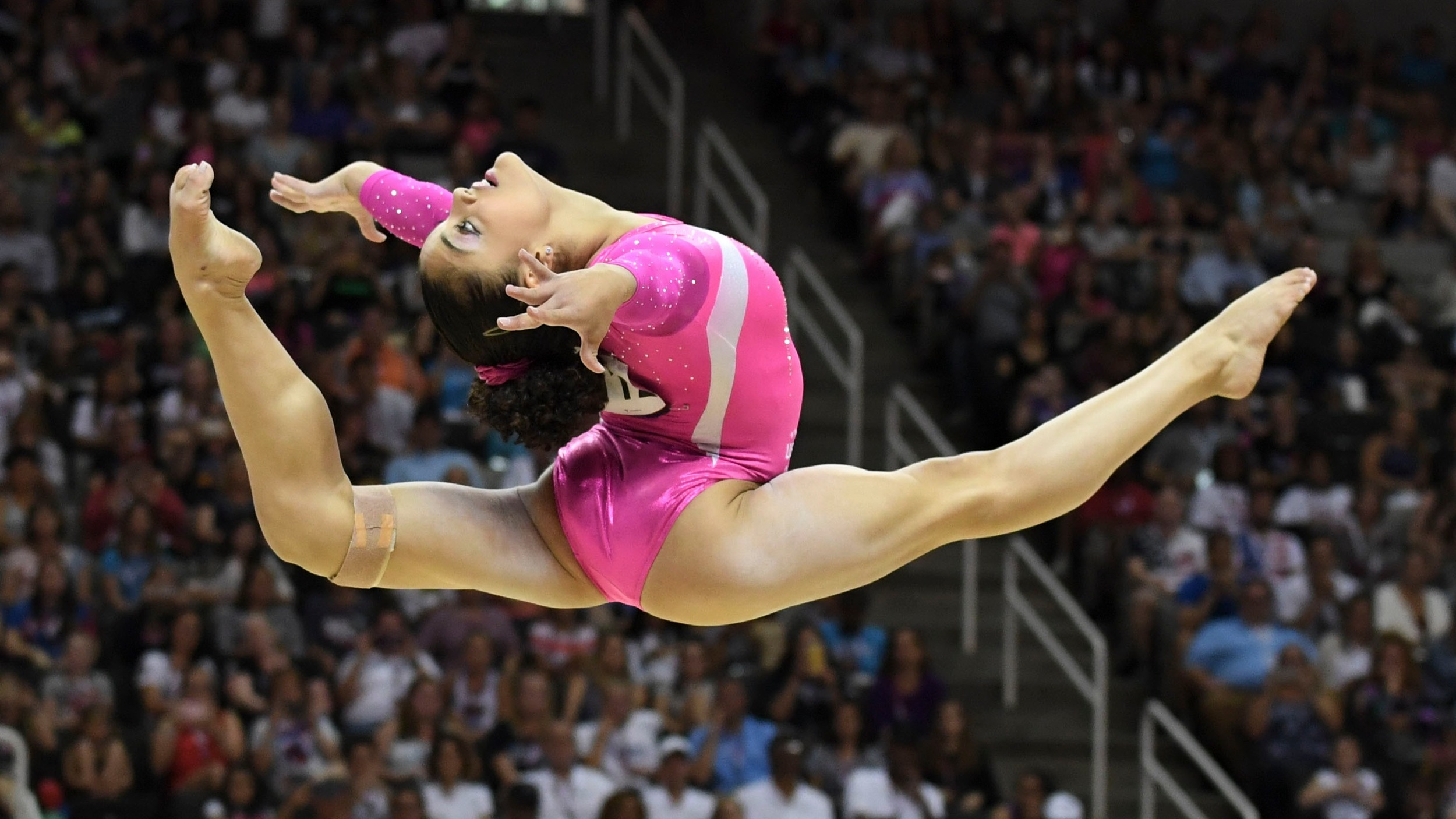 """Underneath the carpet is a 2"""" layer of foam followed by 5//8"""" plywood with 2""""x4"""" springs underneath. The springs were added to give the gymnast height and momentum but to help reduce injury during difficult landings."""