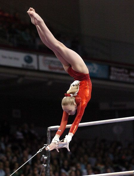 The uneven bars used to be made out of red oak wood with a steel core running through the center but changed to fiberglass with wood coating. A standard bar must have a diameter of 4 centimeters, the low bar set around 5 feet high, and the high bar around 8-9' high. The distance between them ranges from four feet to approximately six feet, and can be brought closer by adjusting the tension cables mounted into the ground.