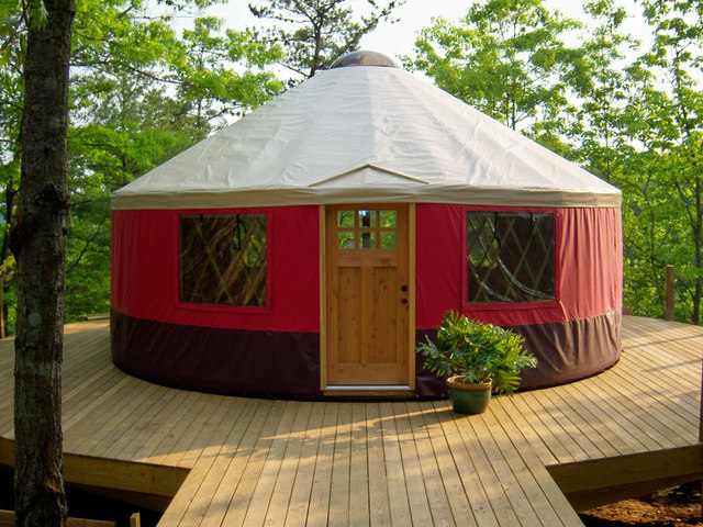 Traditional yurts consist of an expanding wooden circular frame carrying a felt cover