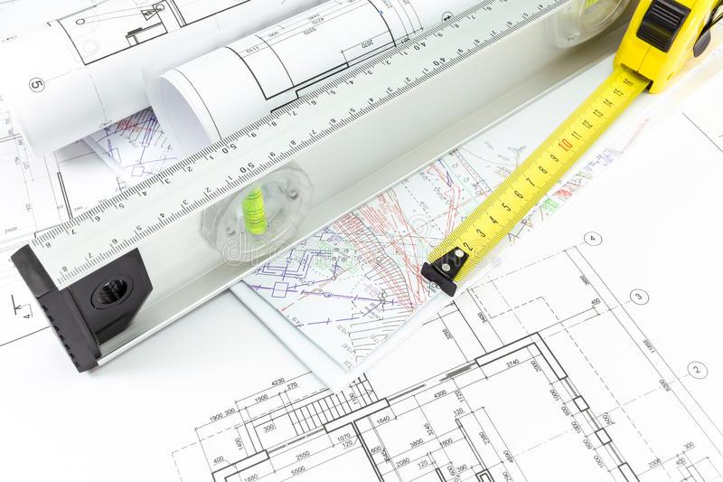 architectural-plans-measurement-tools-house-building-construction-spirit-level-tape-measure-39066997.jpg