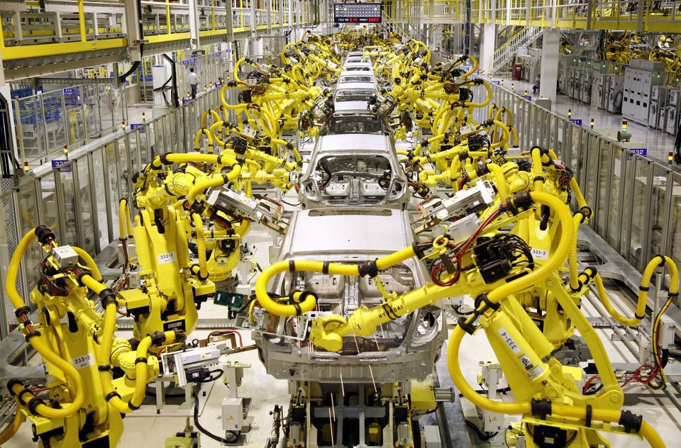 Automated Production Line Assembling, Welding, and Fastening the Modern Auto Frame and Components